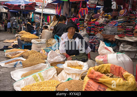 Otavalo, Ecuador - January 13, 2018: indigenous quechua woman selling produce from the ground in the Saturday farmer's - Stock Photo