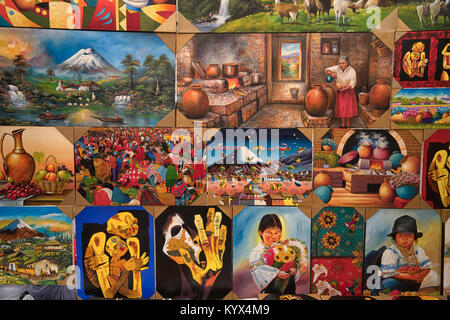 Otavalo, Ecuador - January 13, 2018: closeup of colourful indigenous paintings in the popular artisan market - Stock Photo