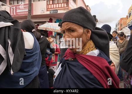 Otavalo, Ecuador - January 13, 2018: closeup of an indigenous quechua woman walking throught th Saturday artisan - Stock Photo