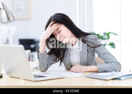 A depressed business woman - Stock Photo