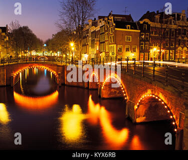 Five Bridges over the Prinsengracht Canal at dusk, Amsterdam, Holland, Netherlands. - Stock Photo