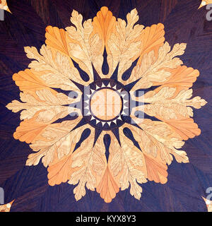 Wooden board with a floral theme painted on it. - Stock Photo