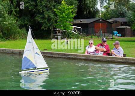 Pensioners enjoying watching model yachts, Woodbridge, Suffolk, England. - Stock Photo