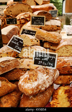 Fresh bread on a market stall. - Stock Photo