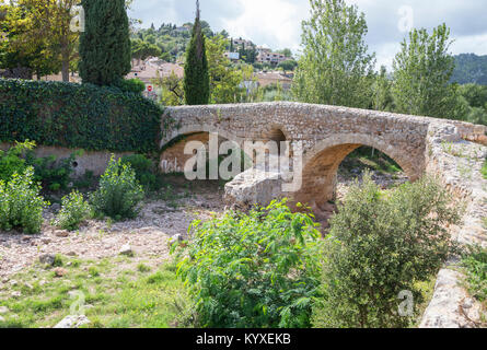 Old Roman double arch stone bridge, Pollenca, Mallorca, Balearic Islands, Spain, Europe - Stock Photo