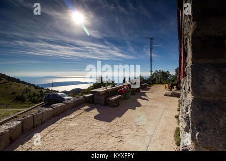 Outdoor benches for refreshments in front of the mountain hut at  Zavizan - Northern Velebit National Park, Croatia - Stock Photo