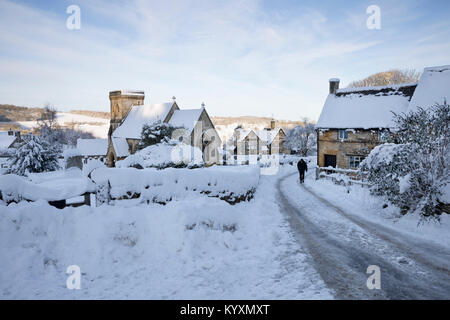 St Barnabas Church and cotswold village in winter snow, Snowshill, Cotswolds, Gloucestershire, England, United Kingdom, - Stock Photo