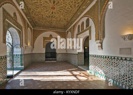 ALCAZAR SEVILLE SPAIN  SUNLIGHT ON ISLAMIC ART IN TILED WALLS AND DECORATED CEILINGS WITHIN A ROOM OF THE PALACE - Stock Photo