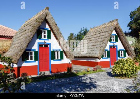 Traditional triangular houses (palheiros) at Santana, Madeira - Stock Photo
