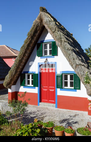Traditional triangular houses (palheiros) at Santana, Madeira - Stock Photo