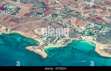 View from the plane to Ayia Napa - the best resort of Cyprus, beaches, gotels, bays, parks. - Stock Photo
