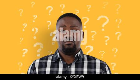 Confused or disgusted man in front of a yellow background with question marks pattern - Stock Photo