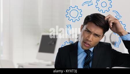 Confused man scratching his head and frowning surrounded by cogs - Stock Photo