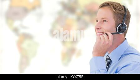 Travel agent man wearing headset in front of world map - Stock Photo