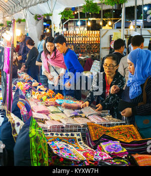 CHIANG MAI, THAILAND - JAN 11, 2017: People at a Night Market in Chiang Mai. Chiang Mai is a second largest city - Stock Photo