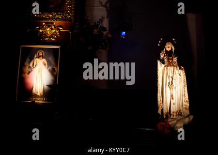 An image of the Virgin of the Sacred Heart and the Christ of the Divine Mercy is displayed in San Francisco church - Stock Photo