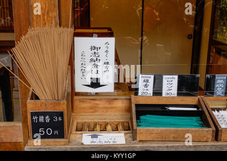 Kyoto, Japan - Dec 26, 2015. Incense and candle for sale at the Shinto Shrine in Kyoto, Japan. - Stock Photo