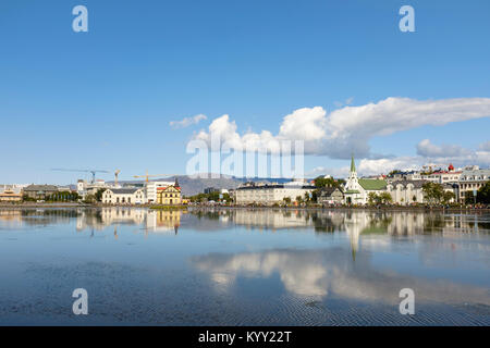 Houses by lake against sky - Stock Photo