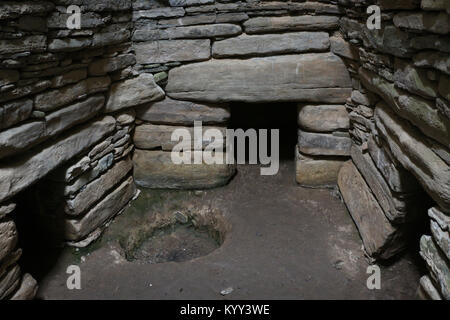 The interior main chamber of Quoyness cairn, located on Sanday Island in Orkney, Scotland. Entrances to 3 of the - Stock Photo