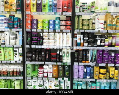 Minsk, Belarus - January 13, 2018: Showcase of a supermarket with hair cosmetics from different manufacturers: shampoos, - Stock Photo