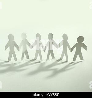 concept of teamwork.team paper men standing - Stock Photo