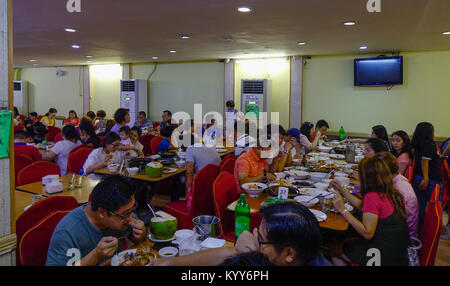 Manila, Philippines - Apr 13, 2017. People eating at Chinese Seafood Restaurant of Seaside Dampa Macapagal in Manila, - Stock Photo