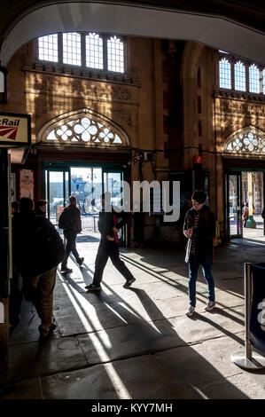 Bristol Temple Meads railway station booking hall entrance with shadows of people - Stock Photo