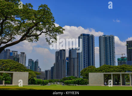 Manila, Philippines - Apr 13, 2017. Manila American Cemetery and Monument with cityscape. Cemetery honors the American - Stock Photo