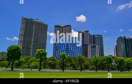 Manila, Philippines - Apr 13, 2017. American Cemetery and Memorial with cityscape in Manila, Philippines. Cemetery - Stock Photo
