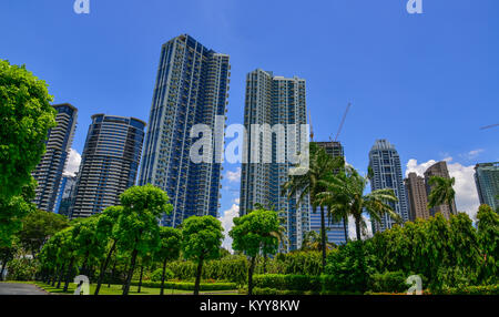 Manila, Philippines - Apr 13, 2017. Office buildings with green park in Manila, Philippines. Manila is the capital - Stock Photo