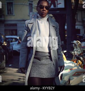 Milan, Italy. 13th Jan, 2018. MILAN- 13 January 2018 Woman on the street during the Milan man Fashion Week Credit: - Stock Photo