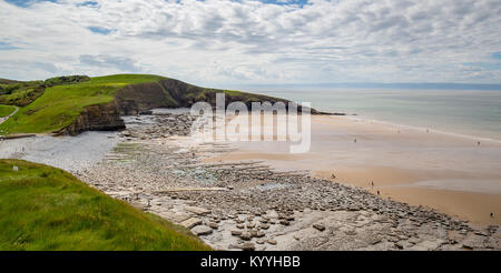 Wide sandy beach of Dunraven Bay at low tide on the Glamorgan Heritage Coast of Soutn Wales UK - Stock Photo