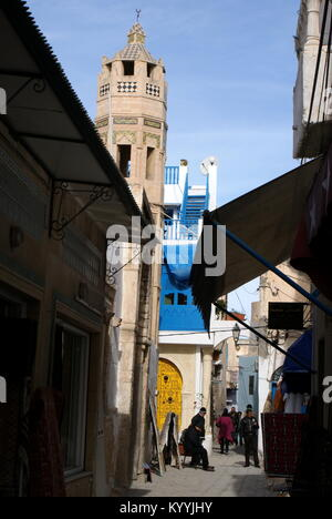 Narrow alley and the octagonal minaret in Sousse medina, Sousse, Tunisia - Stock Photo