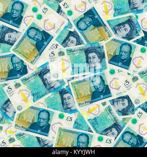 British five 5 pound notes sterling overhead view - new design 2017 - Stock Photo