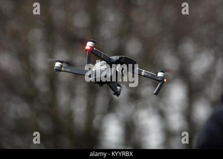 Pic shows: Man flying a drone. DJI Mavic Pro Quadcopter Drone 4K Camera, GPS Positioning,      picture by Gavin - Stock Photo