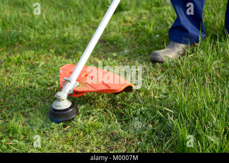 Mowing the grass on the lawn closeup - Stock Photo