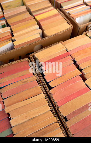 Second hand paperback books for sale on a market stall. - Stock Photo