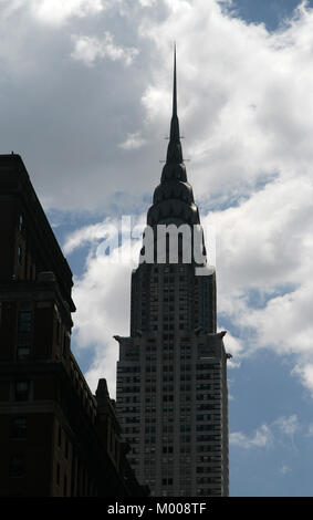 The top of The Chrysler Building seen from street, New York State, New York State, USA. - Stock Photo