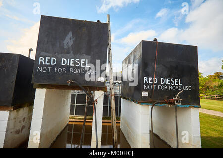 "Tanks of red diesel marked ""not for road use"" on a farm in Oxfordshire - Stock Photo"