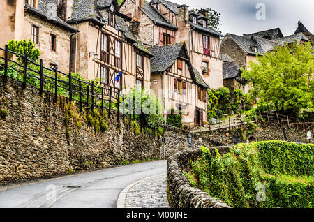 Located on the route of Santiago de Compostela in France we find this medieval village Conques out of a fairy book - Stock Photo