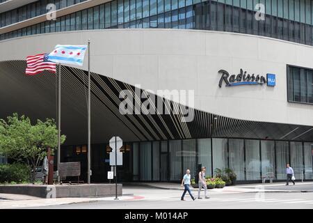 CHICAGO - JUNE 26: People walk past Radisson Blu hotel on June 26, 2013 in Chicago. Radisson Hotels is a major international - Stock Photo