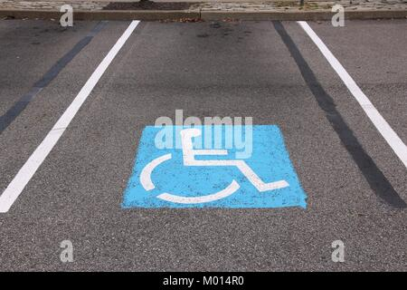 Handicapped parking spot - transportation infrastructure road markings. - Stock Photo