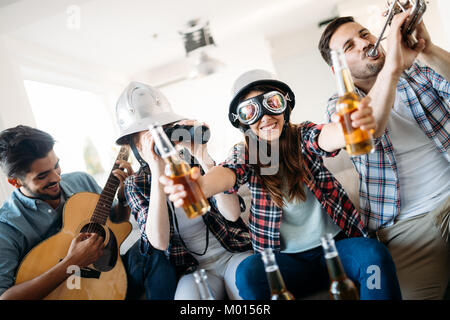 Young students and friends celebrating ahd having fun while drinking - Stock Photo