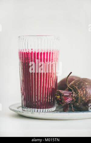 Fresh morning detox beetroot smoothie in glass, white background - Stock Photo