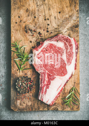 Flat-lay of raw prime beef meat dry-aged steak rib-eye - Stock Photo