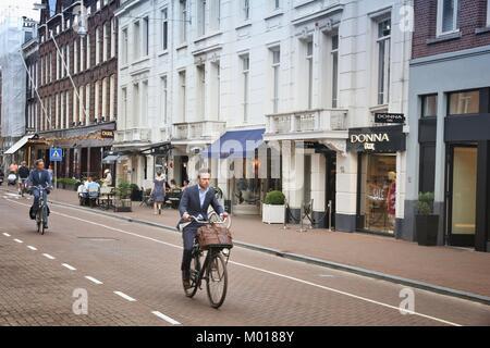 AMSTERDAM, NETHERLANDS - JULY 10, 2017: People visit P.C. Hooftstraat in Amsterdam. Pieter Cornelis Hooftstraat - Stock Photo