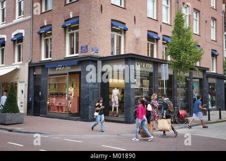 AMSTERDAM, NETHERLANDS - JULY 10, 2017: People visit Prada store at P.C. Hooftstraat in Amsterdam. Pieter Cornelis - Stock Photo