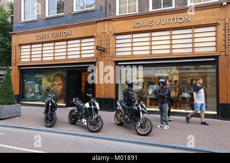 AMSTERDAM, NETHERLANDS - JULY 10, 2017: People visit Louis Vuitton shop at P.C. Hooftstraat in Amsterdam. Pieter - Stock Photo
