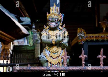 Traditional Balinese Hindu god or demon (unclear) statue at shrine in Gunung Kawi Sebatu Temple, Bali, Indonesia. - Stock Photo
