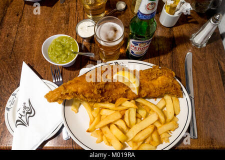 Excellent fish and chips at the famous Magpie Cafe in Whitby served with mushy peas tartare sauce and a drink of - Stock Photo